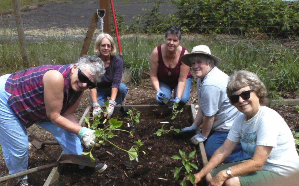 Grange gardeners planting garden